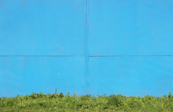 Abstract detailed blue metal wall background texture of sheet  painted with  paint and grass Stock Photos