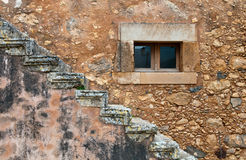 Abstract  details stone wall closed window and stairs Royalty Free Stock Photo