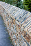 Abstract Diagonal View of Textured Stone wall Royalty Free Stock Photos
