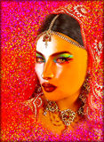 Abstract digital art of Indian or Asian woman's face, close up with colorful veil. An oil paint effect and glowing lights are adde Stock Photo