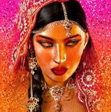 Abstract digital art of Indian or Asian woman's face, close up with colorful veil. Royalty Free Stock Photos