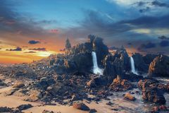 Abstract digital composite of mountans and waterfall. Abstract digital composite of wild land with mountans and waterfall at sunset royalty free stock images
