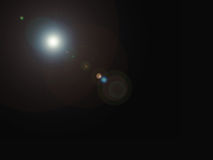 Abstract digital lens flare in black background.  Stock Photos