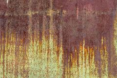 Abstract dirty grunge background in brown and orange tones. Stock Images