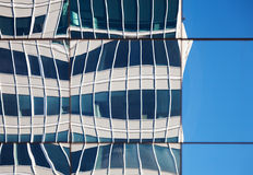 Abstract distorted reflections of walls in windows. Of modern office building Stock Photos