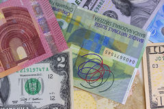 Abstract dollar euro and swiss franc background. Stock Photography