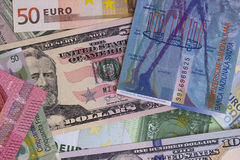 Abstract dollar euro and swiss franc background. Royalty Free Stock Photography
