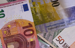 Abstract dollar euro and swiss franc background. Stock Photos