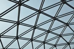 Abstract dome roof pattern. With clear glass and aluminium details towards a blue sky stock photography