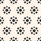 Dotted seamless pattern. Simple floral geometric texture. Abstract dotted seamless pattern. Simple floral geometric shapes. Vector monochrome circles texture Stock Images