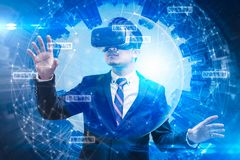 The abstract double exposure image of businessman using a smart glasses or vr glasses overlay with virtual hologram image. stock photos