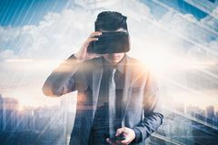 The abstract double exposure image of businessman using a smart glasses or vr glasses overlay with virtual hologram image. the con royalty free stock images