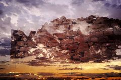 Surreal Stone Wall floating in the sky, Double Exposure. stock images
