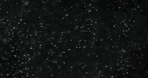 Abstract dust particles on dark background loop seamless ready stock footage
