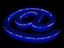 Abstract E-mail symbol in neon light. 3D abstract E-mail symbol in neon light Stock Photography