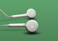 Abstract. Ear phones green background very preety Royalty Free Stock Photo
