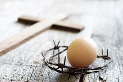 Abstract easter egg and crown of thorns on vintage retro wooden old background stock photo