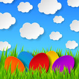 Abstract Easter eggs made of paper on colorful spring background. With green grass, sky and clouds. Vector eps10 illustration Stock Image