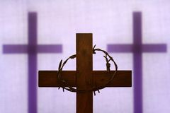 Free Abstract Easter Wooden Cross And Crown Of Thorns On Purple Background Royalty Free Stock Photo - 167342235