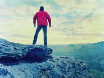 Abstract effect.  Man on mountain summit with sun over clouds Travel hiking Royalty Free Stock Photos