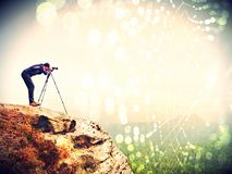 Abstract effect. Nature photographer prepare camera to takes impressive photos of misty fall landscape. Abstract effect. Nature photographer prepare camera to Stock Image