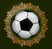 Abstract emlem with ball on the gold frame. Stock Images
