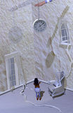 Abstract emotions, no time left. A girl standing in the middle of a white scary room, with a clock held by a loose arm in the middle of it, 3D illustration Stock Photos