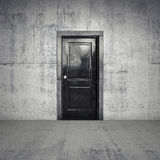 Abstract empty concrete interior with black wooden door Stock Photo
