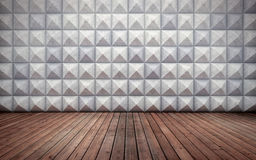Abstract empty concrete interior with polygonal wall pattern and wooden floor Royalty Free Stock Photos