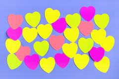 Abstract empty sticky note in the shape of a heart magnet on blue board royalty free stock image