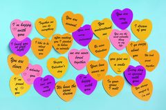 Abstract empty sticky note in the shape of a heart magnet on blue board stock photos