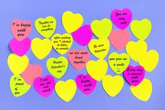 Abstract empty sticky note in the shape of a heart magnet on blue board royalty free stock photography
