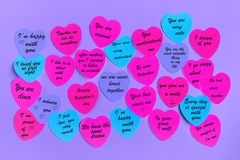 Abstract empty sticky note in the shape of a heart magnet on pink board. stock images