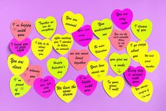 Abstract empty sticky note in the shape of a heart magnet on pink board royalty free stock photo