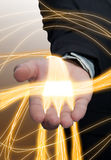 Abstract energy. Abstract energy in the hands of businessmen Royalty Free Stock Photography