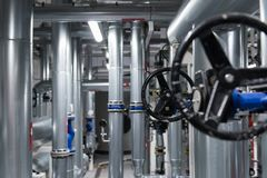 Abstract engineering background with black valve and metal pipes. royalty free stock photos