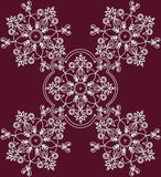 Abstract ethnic floral ornament on red background. Vector Stock Photos