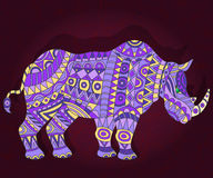 Abstract ethnic illustration with  rhino on a dark floral background Stock Image