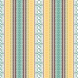 Abstract ethnic seamless pattern, vector illustration, vintage ornamental background. Ornate vertical multicolor colorful tracery. For fabric design, textile stock illustration