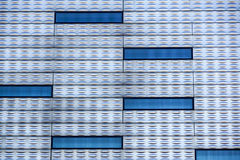 Abstract facade lines and glass reflection on modern building,abstract background.  Royalty Free Stock Images