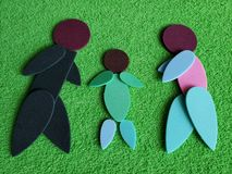 Abstract family figure, with a man, a woman and a son, made with sparkling pieces. Abstract and simple design with stationery material, image for concept and stock images