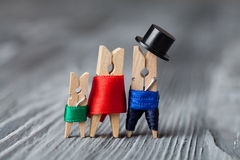 Abstract family of linen clothespins. Stock Photos