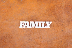 Abstract family sign on rusty metal background Royalty Free Stock Images