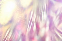 Abstract fancy vibrant holographic foil background. With shiny gleaming reflections and glittering bokeh light effect Royalty Free Stock Images