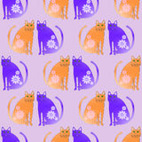 Abstract fantasy cats orange purple with blossoms on lilacSeamless Stock Image