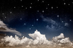Abstract fantasy night sky with clouds and shining Royalty Free Stock Image