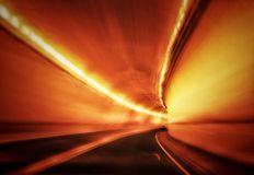 Abstract of fast moving drive through a mountain highway tunnel. royalty free stock photography
