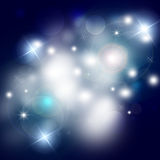 Abstract festive background bokeh. Elegant Christmas blue background bokeh with stars Stock Images