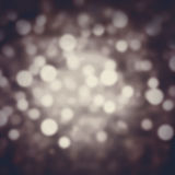 Abstract Festive background. Glitter vintage lights background w Royalty Free Stock Photo