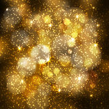 Abstract festive blurred background with sparkling bokeh lights, glittering stars  Royalty Free Stock Photos